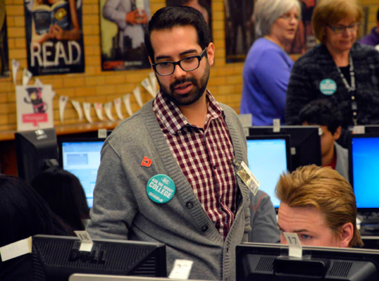 Max Gonzales, Kearns High School's College Access Advisor, works with students as they apply to college during Utah College Application Week, Nov. 12, 2014.