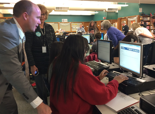 Lt. Governor Spencer Cox helps Kearns HS seniors as they apply to college during Utah College Application Week.
